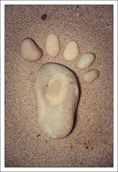 Le pied dans le sable